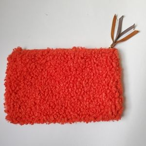 Urban Outfitters faux sheep wool pouch
